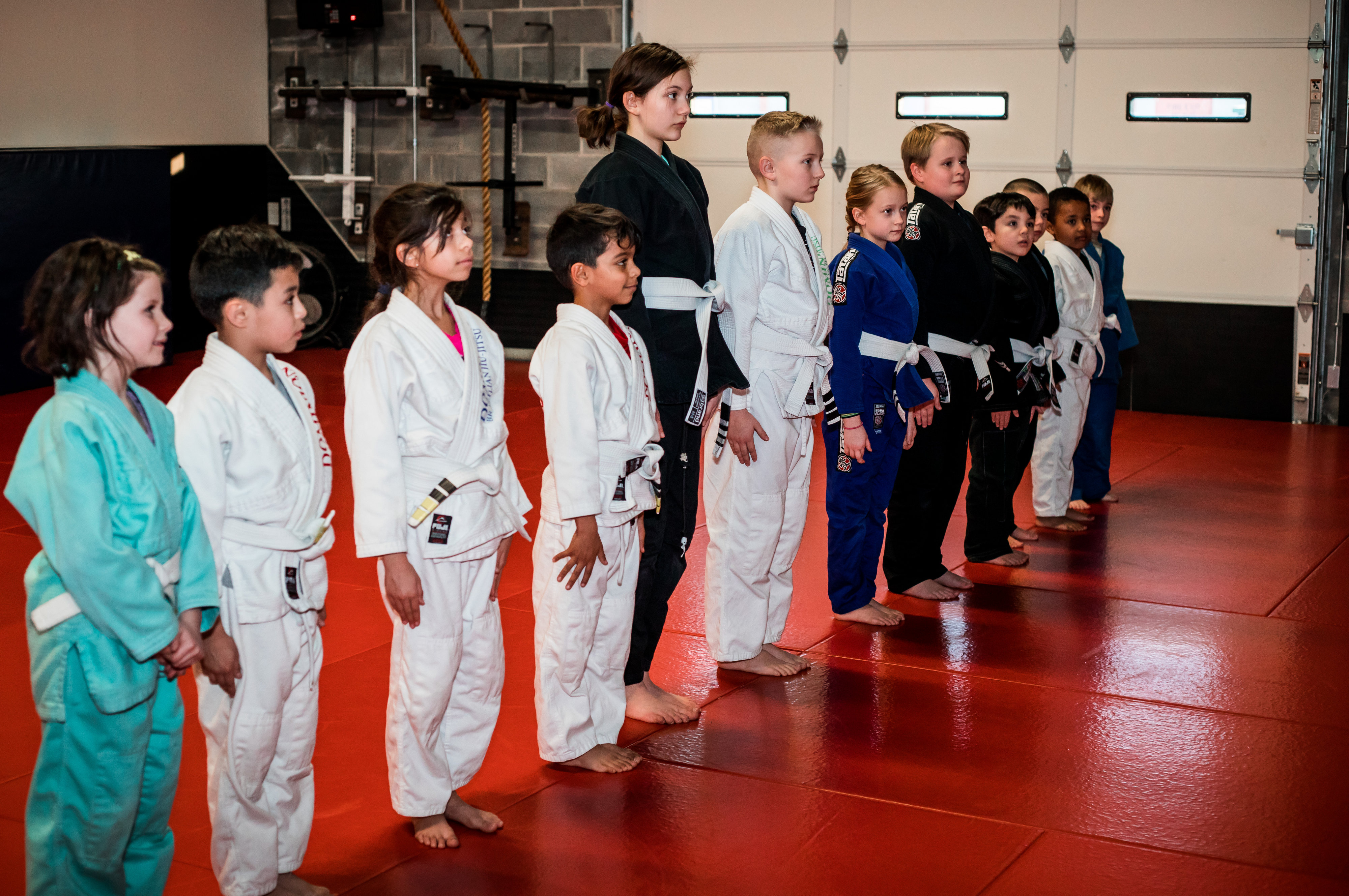 Dominion Kids BJJ class lines up to start class