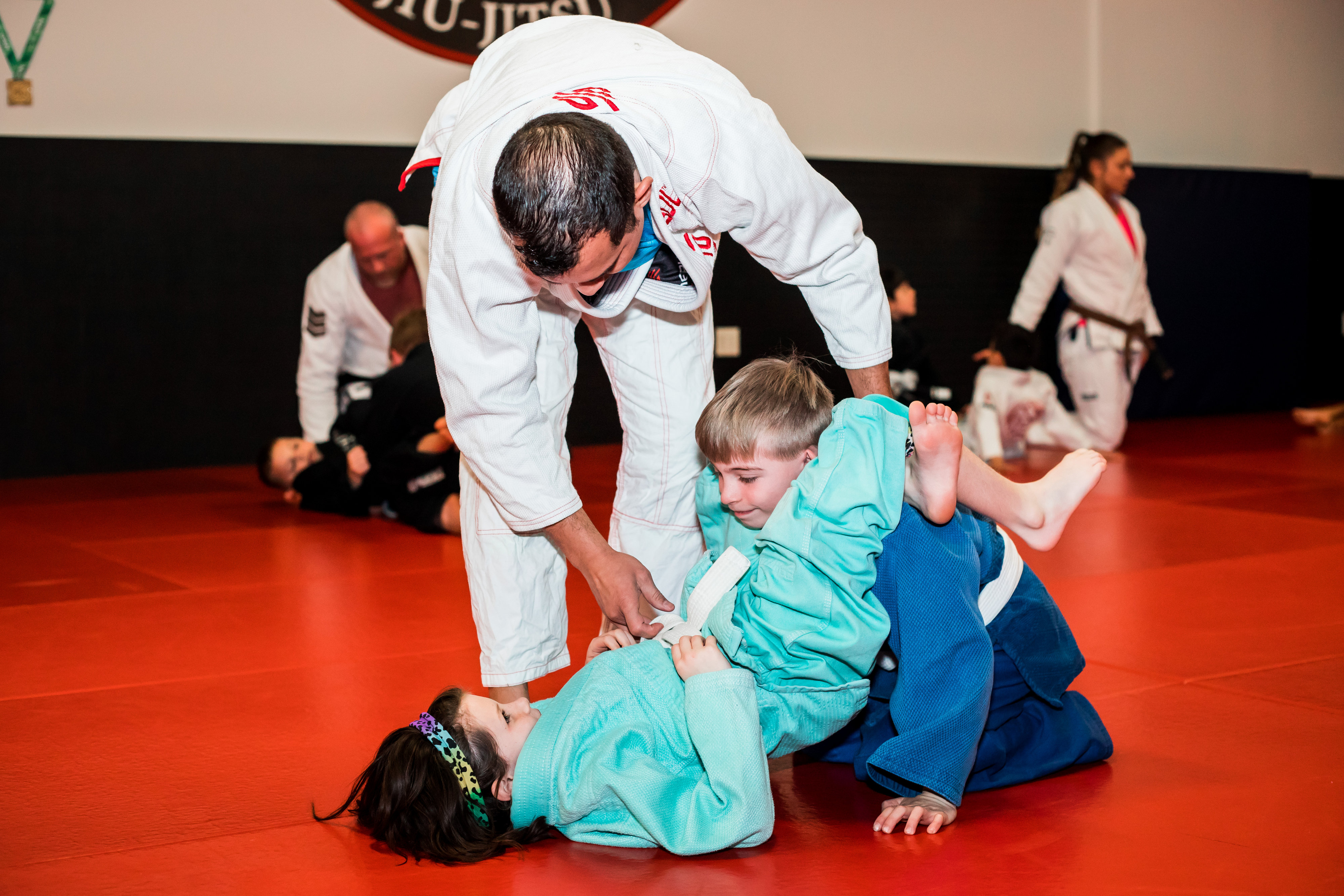 Dominion BJJ kids drilling the triangle choke